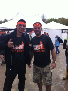 Post Tough Mudder. This is after showering and getting dressed...forced smiles bc the camera person asked us to :-)